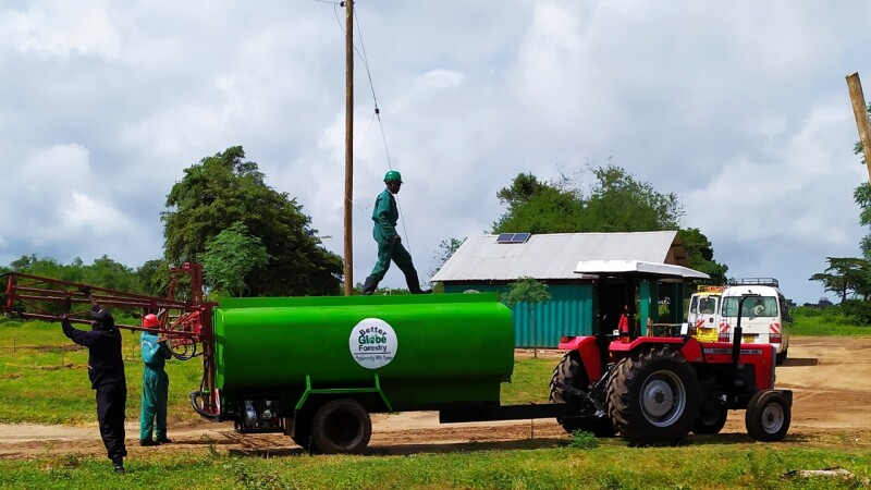 Sustainability farmers working with a tractor and trailer
